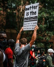 South Carolina football player Jay Urich protesting with the team in Columbia on Friday, June 5.
