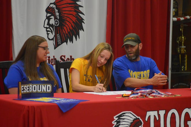 Tioga senior Kaitlyn Brown (center) signed with McNeese State Monday.