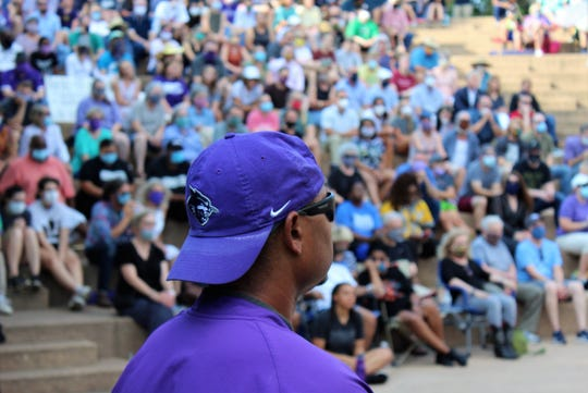 The crowd at Abilene Christian University's amphitheater Sunday evening filled the shaded area to hear more than a dozen speakers at a community rally.
