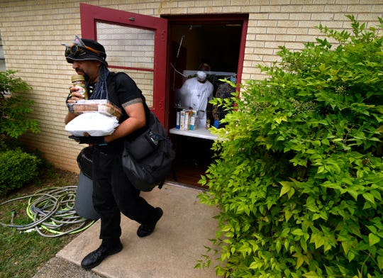 A client leaves the soup kitchen run by Iziar Lankford. He has been serving food for those in need each Tuesday at different churches for the last decade.