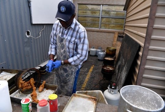 J.D. Wilson cooks fried chicken at Bethel United Methodist Church June 2 for Iziar Lankford's soup kitchen. Wilson, a member of Mt. Zion First Baptist Church, is a retiree who volunteers with Lankford.