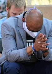 Hardin-Simmons University professor Kelvin Kelley, bows his head in prayer during Sunday's community rally at Abilene Christian University. Kelley was one of more than a dozen speakers addressing racial unrest and solutions.