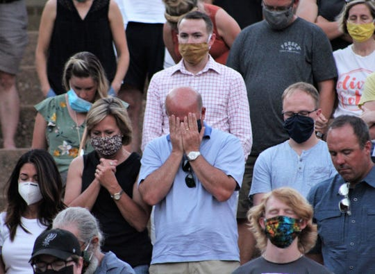 Heads bowed and eyes closed, those attending Sunday evening's community rally at Abilene Christian University prayed for dialogue and change at its end. The vast majority of the crowd was white. June 7 2020