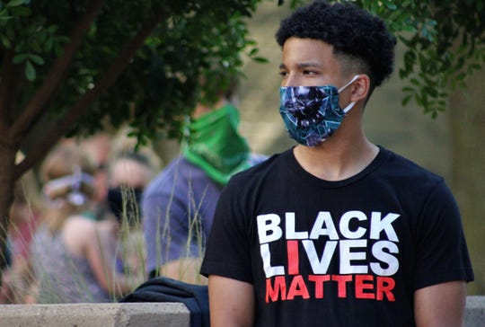 Roland Campos assisted with the community rally Sunday at Abilene Christian University. He is the president of Nu Kappa Psi, or Noble Kings, a predominantly black fraternity.