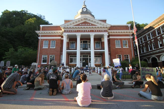 Participants in a vigil for racial justice June 6 in Marshall knelt for 8 minutes 46 seconds to memorialize the final minutes in the life of George Floyd.
