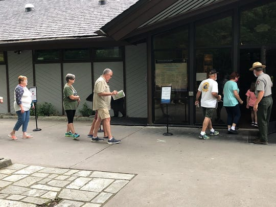 Visitors line up the morning of June 8 to enter Sugarlands Visitor Center in Great Smoky Mountains National Park. The park, which also reopened Oconaluftee, Cades Cove and Clingmans Dome visitor centers June 8, is only allowing a limited number of people inside at a time due to coronanvirus precautions.