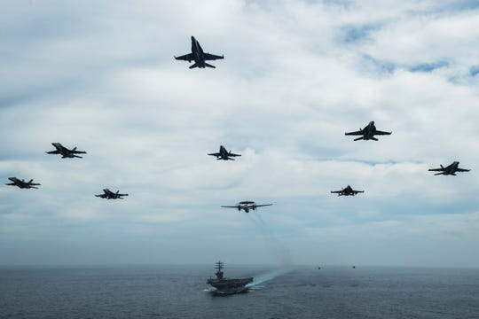 Aircraft from Nimitz Carrier Strike Group June 2 fly in formation over the group's Bremerton-based capital ship. The Nimitz deployed Monday out of San Diego.