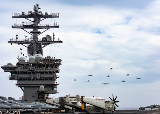 Aircraft assigned to the Nimitz Carrier Strike Group fly in formation over the aircraft carrier USS Nimitz June 2. The Nimitz departed for deployment Monday.