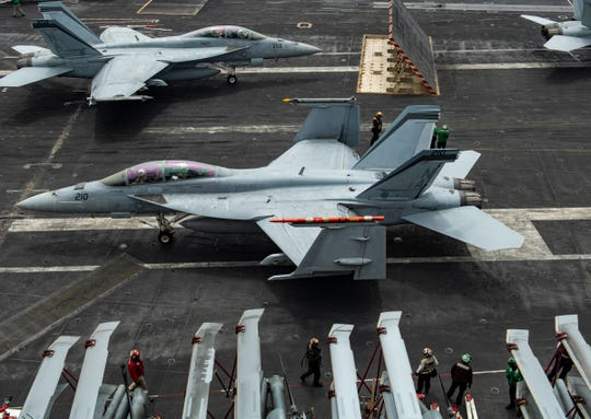 "F/A-18E Super Hornets, from the ""Mighty Shrikes"" of Strike Fighter Squadron (VFA) 94, prepare to launch off the flight deck aboard the aircraft carrier USS Nimitz May 31. The Nimitz Carrier Strike Group deployed from San Diego Monday."