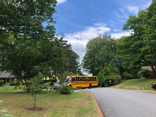 A South Burlington school bus makes its way on Brewer Parkway on Tuesday, June 2, 2020. The South Burlington School District has been delivering meals to students using the buses after in-person classes were shutdown in March due to the coronavirus pandemic.