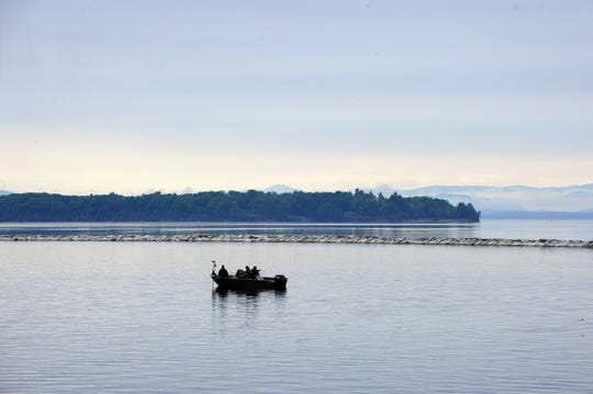 Three men fish in a boat on Lake Champlain inside the breakwater near Perkins Pier in Burlington on Wednesday, June 3, 2020.