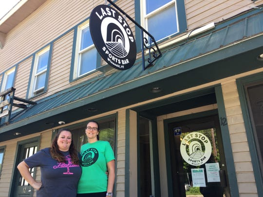 Shayla Ruland, left, owner of the Last Stop Sports Bar, stands with her sister, bartender Kaitlyn Ruland, outside the Winooski bar June 8, 2020.