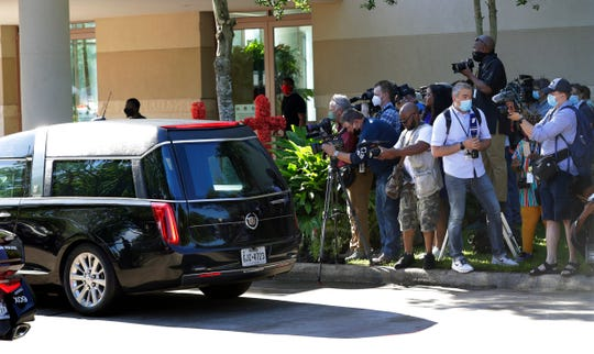 Media prepare to cover the arrival of George Floyd's casket to a public memorial at The Fountain of Praise church in Houston, Monday, June 8, 2020.  (AP Photo/Eric Gay)