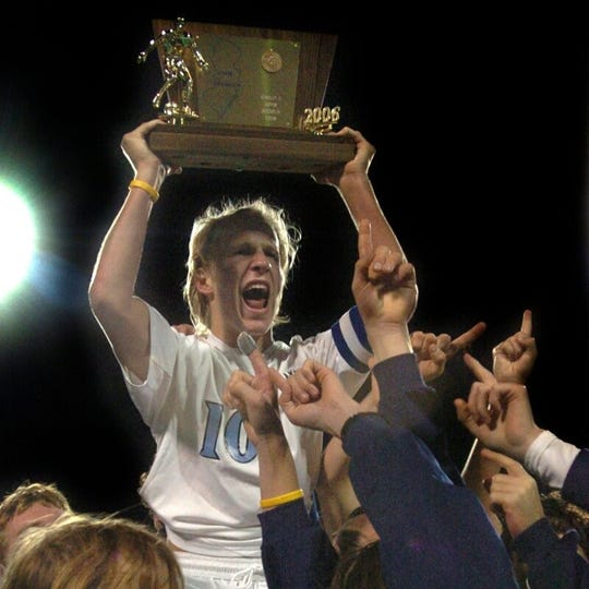 Shawnee soccer captain Brad Franks is hoisted onto the shoulders of his teammates as he proudly displays the 2006 NJSIAA Group 3 championship trophy.