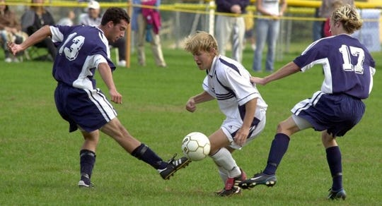 Shawnee High School's Jamie Franks (center) was the 2014 Burlington County Times' Boys Soccer Player of the Year.