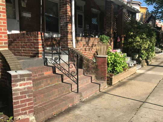 A Woodlynne police officer has been suspended after an alleged pepper-spraying incident involving a young man sitting on the stoop, foreground, of a Parker Avenue home.