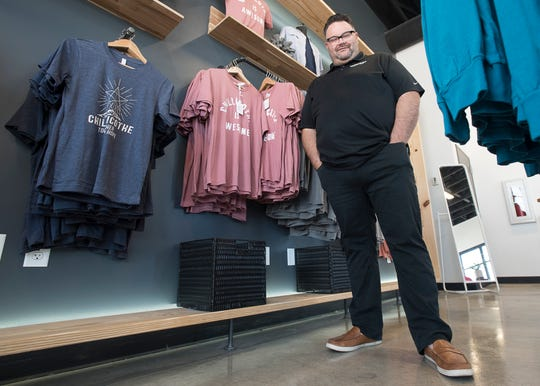 """Owner of Hometown Apparel and  Screen Printing Ben Thompson designed a shirt called """"Together in Hope"""" as a sign of solidarity during the coronavirus epidemic."""