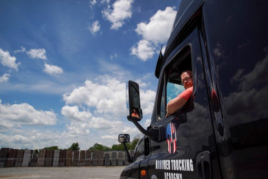 "Kris Grempler, owner of Armored Trucking Academy, looks out his window while practicing a ""90"" move backing up between cones Friday, June 5, 2020."