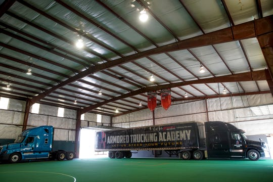 Two trucks owned by Kris Grempler, the owner of Armored Trucking Academy, are used by students for practice.