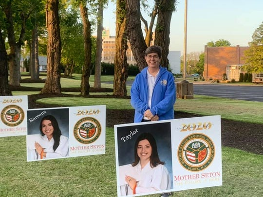 Sister Jacquelyn, principal of Mother Seton Regional High School, stands on the front lawn of the school while celebrating the members of the Class of 2020. Under her direction, the school lined the outskirts of its property with individual signs for each of the graduates.