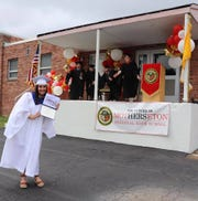 """Madison Miranda of Union, member of MSR's Class of 2020, holds her diploma proudly and is """"socially distant"""" as she stops for a picture with her principal and the members of Mother Seton's Administrative Team."""