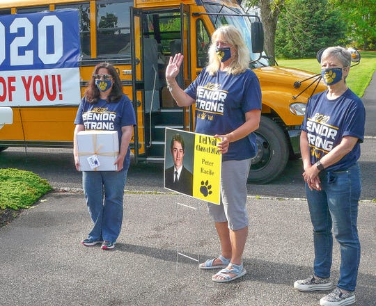 Arriving at the Kingwood Township driveway of graduating Del Val senior Peter Racile are (from left) Superintendent Daria Wasserbach, Principal Adrienne Olcott and Board President Ellen Gordon-Obal.