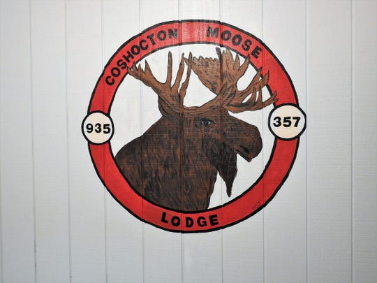 The emblem of the Coshocton Moose Lodge recently painted in the foyer of the building.
