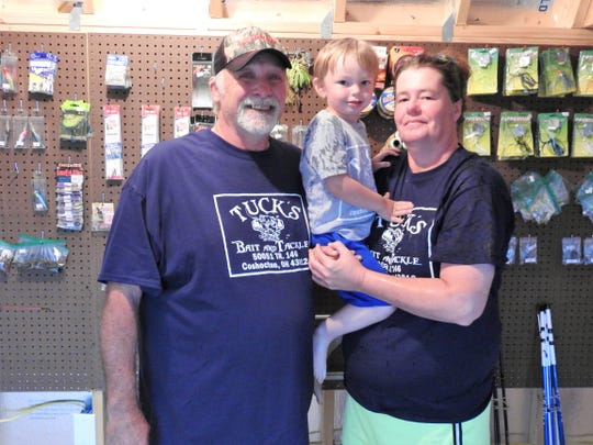 Ken and Amy Jennings with their son, Tucker, 2-years-old, in the business named for him, Tuck's Bait and Tackle. The shop opened about a month near Wills Creek offers live bait, rods and reels, fishing line, worms, chicken livers and more.
