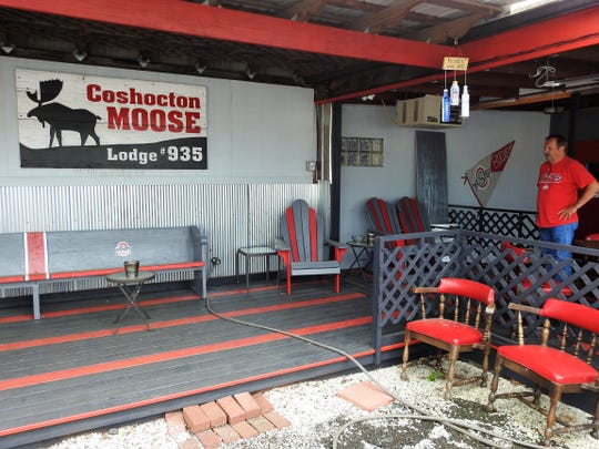 Lloyd Ridenbaugh, administrator for the Coshocton Moose Lodge, looks at renovations to the patio area of the building. The interior and exterior of the facility was updated during the recent closure related to the COVID-19 pandemic.