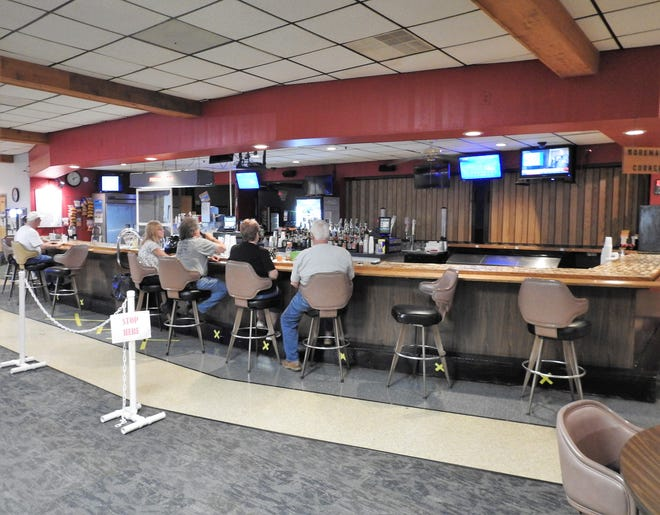 Patrons of the Coshocton Moose Lodge sit at the bar, which was recently painted and had other work done during the COVID-19 pandemic closure. Members donated funds and lodge employees and others volunteered to do the work, which also included new ceiling tiles, carpeting and painting.