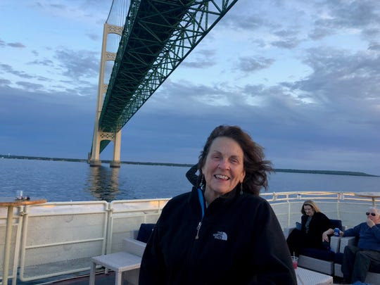 Mary McCourt Dufina, owner of the Loon Feather on Mackinac Island, is seeing a lot of first-time visitors in 2020. She is pictured here on a Sip & Sail Cruise under the Mackinac Bridge on August 22, 2019.