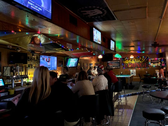 Customers return to Kozy Lounge in Hazel Park just after midnight Monday morning.