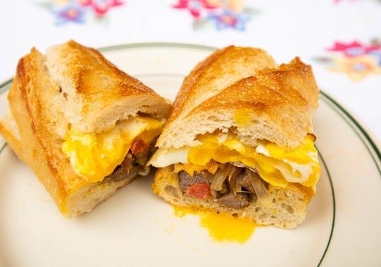 A steak 'n' egg baguette is one sandwich idea for breakfast in the morning.