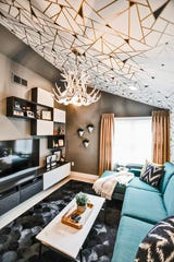 A geometric wallpaper from Duralee adds a modern touch to the TV room in Jerry and Lisa Zimmer's Northville Township home.