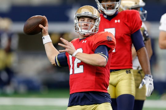 At Notre Dame, workout groups for players like QB Ian Book will be structured by academic schedules.