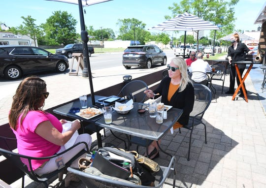 Lisa Hysko-Cuppetilli and Stephanie Schrack have lunch in the outside dining area of Mojave Cantina in Clawson.