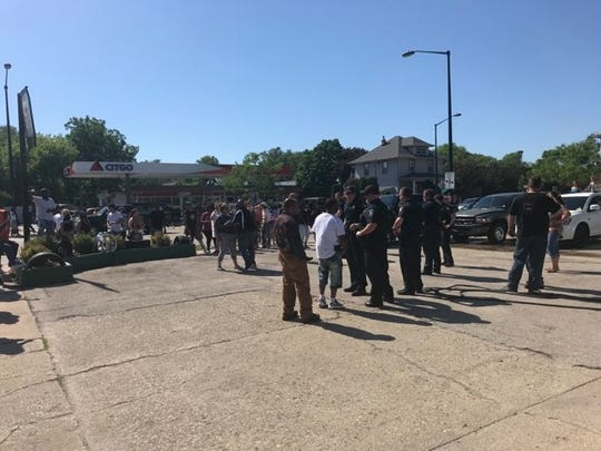 "Protesters gathered Monday afternoon outside a Fond du Lac business. The gathering got heated with those attending shouting: ""No justice, no peace."""