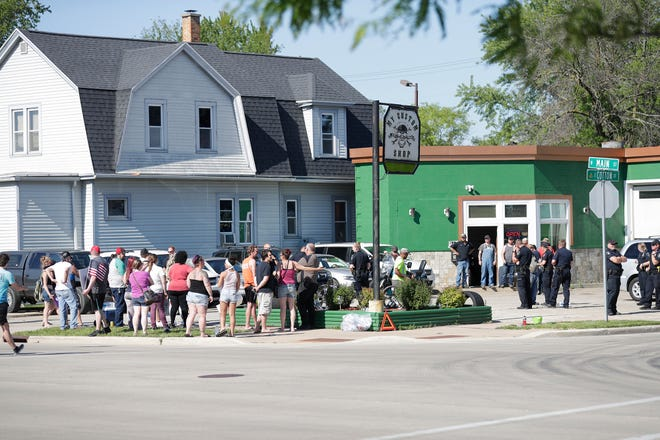 A crowd gathered Monday, June 8, 2020, on north Main and Cotton Street in the City of Fond du Lac, apparently protesting remarks a business owner in the area made about the Black Lives Matter movement on Facebook. Doug Raflik/USA Today NETWORK-Wisconsin