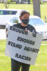 A protest against racial injustice was held in front of the Ottawa County Courthouse Monday.