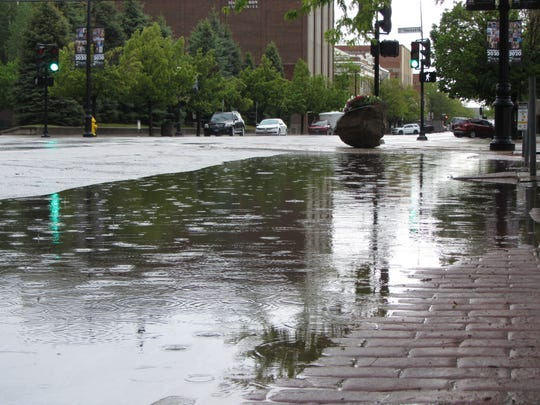 Sunday and Monday's rain left some big puddles in downtown Great Falls thanks to a weather system that moved through the state this weekend.
