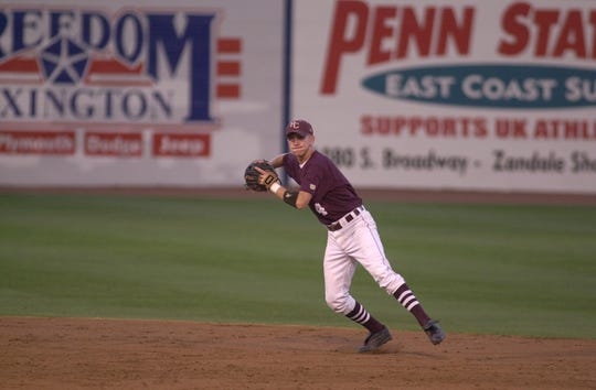 Henderson County shortstop Dustin McGill (4) looks to first base as he makes the catch during the 2000 state semifinal game against Nicholas County in Lexington.