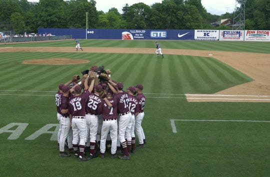 The Henderson County Colonels huddle up before taking infield before the 2000 state semifinal game with Nicholas County at Cliff Hagan Stadium in Lexington.