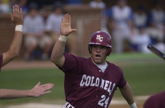 Henderson County's Neil Sellars heartily slaps the hands of his teammates after scoring during the 2000 state semifinal game against Nicholas County at Cliff Hagan Stadium in Lexington.