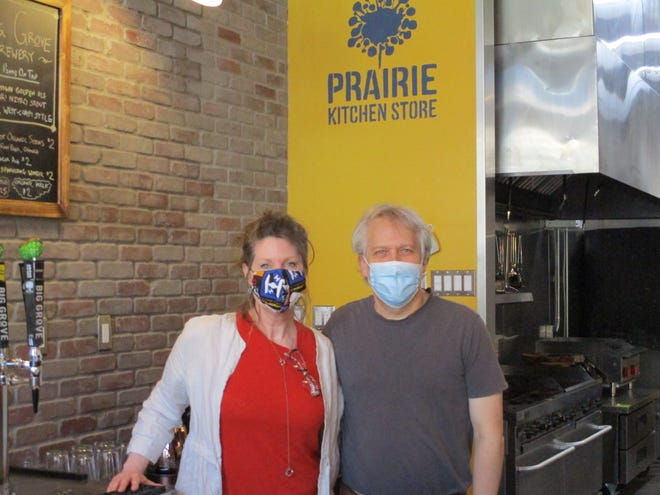 Owners Kevin and Susan Felker of Prairie Kitchen, 160 N. Linn St., pose for a picture in their store on June 8, 2020.