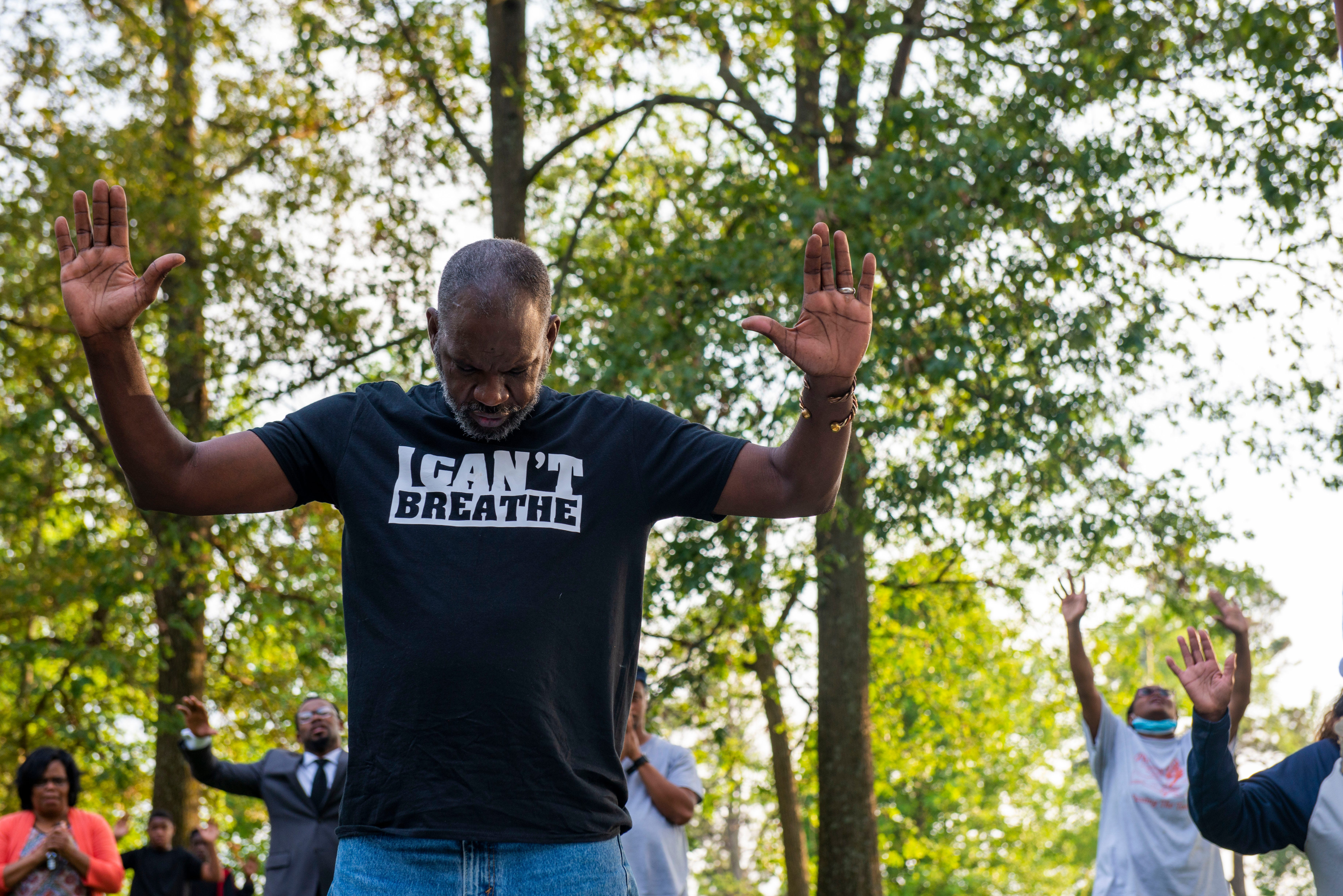 Michael Porter prays with the Gibson County community at Viking Park to peacefully protest police violence against the Black community in Humboldt, Tenn., on June 4.