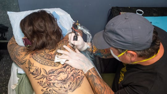 Tattoo Artist Terry Grow and customer Elizabeth Satterly at Triple A Tattoo & Piercing,  1548 Johnston St in Lafayette, LA. Monday, June 8, 2020.