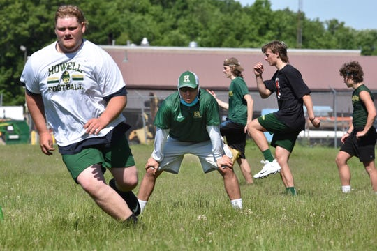 Howell senior Chadley Pace works out under the watchful eye of head football coach Brian Lewis on Monday, June 8, 2020.