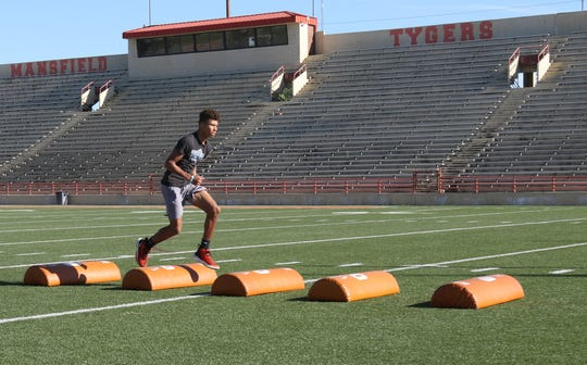 The Mansfield Senior Tygers football team got back to work on Monday morning with a social distanced workout for the first time since the coronavirus pandemic rocked the area.