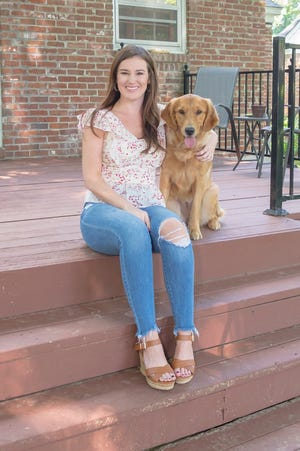Kaitlyn Grant and her constant companion, Nellie, love their new home.