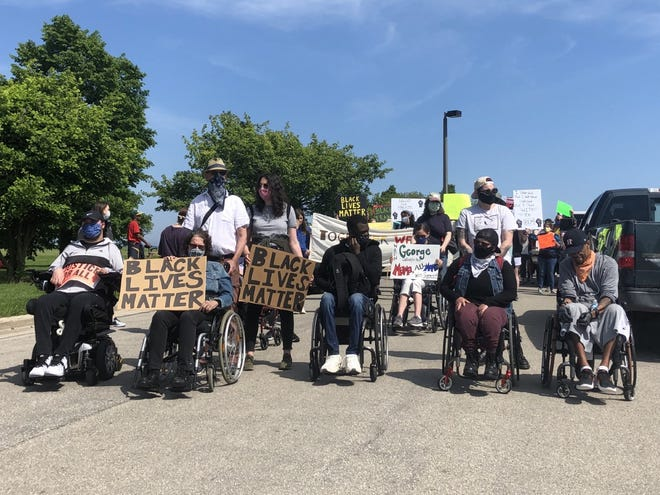 Organizers with disabilities led a march Sunday starting at Veterans Park.